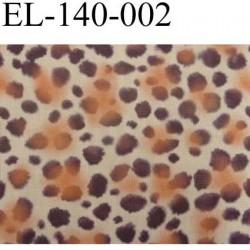 élastique plat très belle qualité couleur léopard  fond beige et des taches orange et marron largeur 140 mm rigide prix au mètre