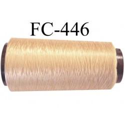 Cone de fil n° 210 mousse texturé polyester très solide couleur blond gold or lumineux longueur 1000 mètres bobiné en France