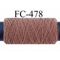 bobine de fil élastique fronceur ou à smock gomme lycra polyamide marron clair longueur de la bobine 20 mètres diamètre 0.05 mm