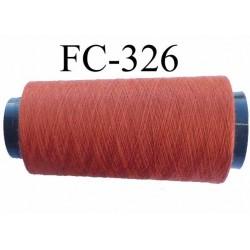 Cone ( Economique ) de fil  polyester  fil n°120 couleur rouille longueur du cone 2000 mètres bobiné en France