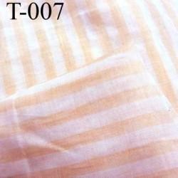 tissus 100 % coton ajouré couleur saumon et écru a rayures largeur 155 centimètre  prix au mètre