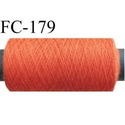 bobine de fil n° 120 polyester couleur orange longueur de la bobine 200 mètres bobiné en France