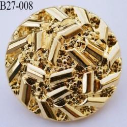 bouton 27 mm en pvc couleur doré or accroche au dos avec un anneau a diamètre 27 millimètres