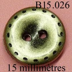 bouton 15 mm couleur doré avec dans les trous incrustation de peinture noir 2 trous diamètre 15 millimètres