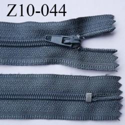 fermeture zip longueur 10 cm couleur bleu tirant sur le gris non séparable largeur 2.4 cm glissière nylon largeur  4 mm
