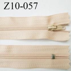 fermeture zip longueur 10 cm crème ou beige clair non séparable largeur 2.4 cm glissière nylon largeur  4 mm