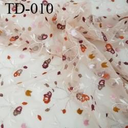 dentelle brodé  sur tulle  couleur chair rosé très haut de gamme largeur 132 cm  prix pour 10 centimètres