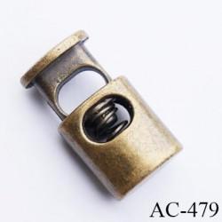 Stop cordon jusqu'au 5 mm couleur laiton hauteur 21 mm largeur 11.5 mm épaisseur 7.5 mm passage du cordon en largeur 6.5 mm