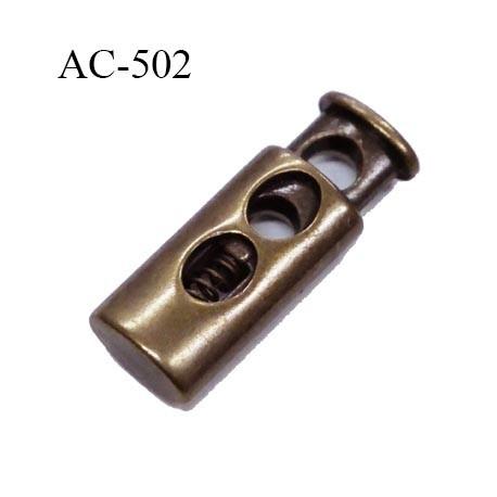 Stop cordon 2 trous  4 mm couleur laiton hauteur 27 mm largeur 10 mm épaisseur 6 mm passage du cordon max en largeur 4 mm