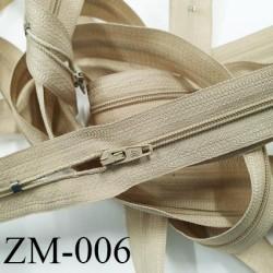 fermeture 70 cm monté sur rouleau couleur BEIGE 1 curseur par fermeture de 70 cm largeur 25 mm largeur du zip 4 mm