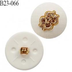 Bouton 23 mm en pvc couleur blanc avec motif doré accroche avec un anneau diamètre 23 mm épaisseur 7.5 mm prix à l'unité