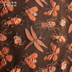 Tissu lycra très haut de gamme couleur marron  des motifs insectes en relief largeur 130 cm  prix pour pour 10 cm  par 130 cm