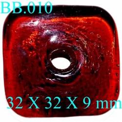 pièce en verre percé  couleur orange foncé 32x32x9 mm   POUR REPARER OU CREER VOS BIJOUX BICHE DE BERE