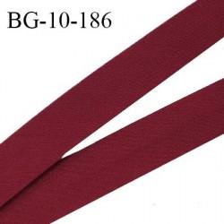 Biais galon 10 mm pré plié au dos 2 rabats de 5 mm coton polyester couleur rouge pourpre largeur 10 mm prix au mètre