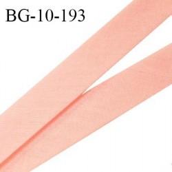 Biais galon 10 mm pré plié au dos 2 rabats de 5 mm coton polyester couleur rose saumon largeur 10 mm prix au mètre