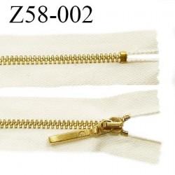 Fermeture zip 58 cm couleur beige longueur 58 cm largeur 2.8 cm non séparable glissière métal couleur doré prix à l'unité