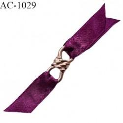 Noeud lingerie haut de gamme boucle métal couleur doré et pans satin couleur pourpre largeur 70 mm hauteur 12 mm prix à la pièce
