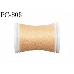 Bobine 500 m fil mousse polyamide n° 120 couleur beige rosé lumineux longueur de 500 mètres bobiné en France