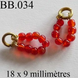 perle  biche de bere  monté  longueur 18 mm largeur 9 mm  couleur orange rouge vendu a la pièce