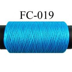 bobine de fil mousse polyamide couleur bleu turqoise longueur 200 mètres largeur de la bobine 5.5 cm diamètre 2.5 cm