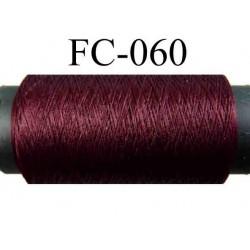 bobine de fil mousse polyamide couleur prune longueur 200 mètres largeur de la bobine 5.5 cm diamètre 2.5 cm