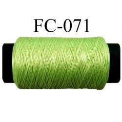 bobine de fil mousse polyamide couleur vert anis lumineux longueur 200 mètres largeur de la bobine 5.5 cm diamètre 2.5 cm