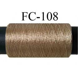 bobine de fil nylon n° 2/70 couleur bronze marron doré très brillant long 200 mètres largeur de la bobine 5.5 cm diamètre 2.5 cm