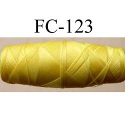 cocon bobine de fil nylon épaisseur 120/2 couleur jaune longueur 200 mètres largeur du cocon 4 cm diamètre 1.5 cm