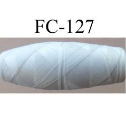 cocon bobine de fil polyester épaisseur 120/2 couleur blanc cassé longueur 200 mètres largeur du cocon 4 cm diamètre 1.5 cm