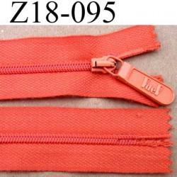 fermeture  éclair  longueur 18 cm couleur orange non séparable largeur 2.5 cm glissière en nylon largeur 4 mm curseur métal