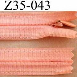 fermeture éclair invisible longueur 35 cm couleur rose orangé saumon non séparable largeur 2.2 cm glissière nylon largeur 4 mm
