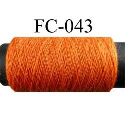 bobine de fil polyester n° 120 couleur orange longueur 500 mètres largeur de la bobine 5.5 cm fabriqué en France