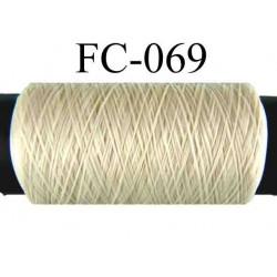bobine de fil mousse polyamide couleur ecru longueur 500 mètres largeur de la bobine 5.5 cm fabriqué en France