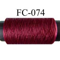 bobine de fil mousse polyester couleur bordeau longueur 500 mètres largeur de la bobine 5.5 cm fabriqué en France