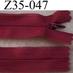 fermeture éclair invisible longueur 35 cm couleur bordeau non séparable largeur 2.7 cm glissière nylon largeur 4.5 mm