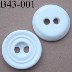 bouton  diamètre 43 mm  pvc couleur blanc rainuré 2 trous de 7 mm