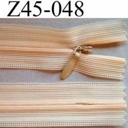 fermeture zip  invisible longueur 45 cm couleur abricot pèche clair non séparable largeur 2.3 cm glissière nylon largeur 4 mm