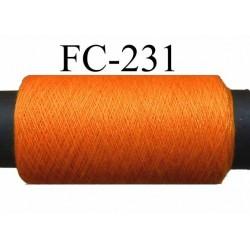 bobine  de fil n° 120 polyester couleur orange lumineux longueur de la bobine 500 mètres bobiné en France