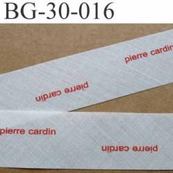 biais à plier PIERRE CARDIN couleur  blanc cassé et texte en rouge largeur 30 mm prix au mètre