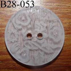 bouton fantaisie 28 mm  couleur blanc translucide avec motifs floraux en relief ton sur ton  2 trous  diamètre 28 millimètres