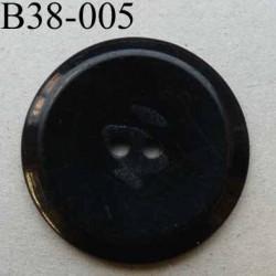 bouton 38 mm couleur noir avec une marque au centre et bordure biseauté 2 trous