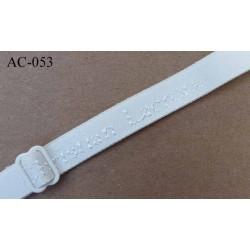 bretelle réglable gauche de soutien gorge CHRISTIAN LACROIX longueur 30 cm largeur 15 mm ivoire haut de gamme