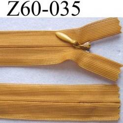 fermeture zip invisible longueur 60 cm couleur caramel ou moutarde non séparable largeur 2.5 cm glissière nylon largeur 4 mm
