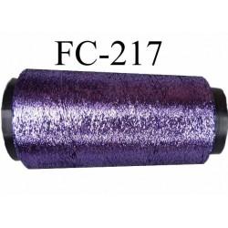 Cone de fil lurex  couleur violet très très brillant  62 % polyester 38 % polyamide longueur de 2000 mètres