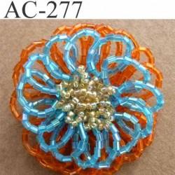 broche  montée en perles sur épingle couleur orange bleu et doré brillante épaisseur 19 mm diamètre 5 cm superbe