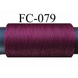bobine de fil polyester continu fil n° 120  couleur  bordeau longueur 500 mètres bobiné en France