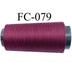 Cone de fil polyester continu fil n° 120  couleur  bordeau prune longueur 2000 mètres bobiné en France
