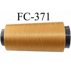 Cone fil polyester continu n° 70/2  couleur bronze doré clair brillant lumineux  longueur cone de 1000 mètres bobiné en France