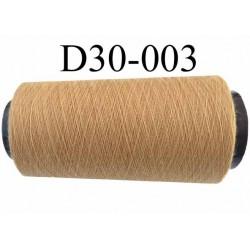 Cone ( en Destockage ) de fil  polyester  fil n° 70/2 couleur beige  longueur du cone 2000 mètres bobiné en France