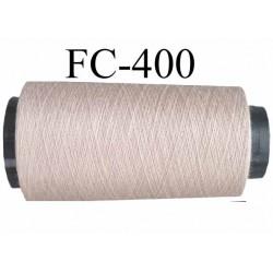 Cone de fil polyester fil n°100 couleurgris mastic  longueur du cone 5000 mètres bobiné en France